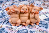 Piggy bank in paper money — Stock Photo