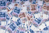 Piggy bank in paper money — Stock Photo