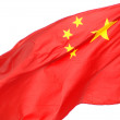 Stock Photo: The flying national flag of the People's Republic of China.