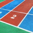 The colorful courses with white numbers on the playground. — Stock Photo