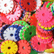 The plastic gear wheels of different contrast colors background. — Stock Photo