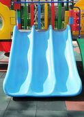 The colorful plastic slide in a kindergarten. — Stock Photo