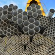 The round steel tubes of various size and caliber pile background. — Stock Photo #2479257