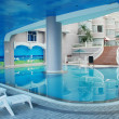 The indoor hotel swimming pool - Stock Photo