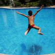 Royalty-Free Stock Photo: Boy jumping in swimming pool