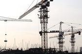 Concrete formwork and crane on construction site — Stock Photo