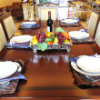 The dinner table,chairs and settings. — Stock Photo