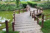 Winding stone pavement bridge garden — Stock Photo