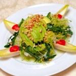 Salad from avocado, pine nuts — Stock Photo
