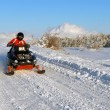 Mgoes on snowmobile — Stock Photo #2162839