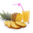 Pineapple with slices and juice — Stock Photo