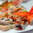 It is a lot sushi on a celebratory table — Stock Photo #2163624