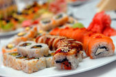 It is a lot sushi on a celebratory table — Stock Photo