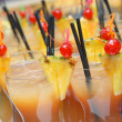Постер, плакат: Cocktails with slices of pineapples