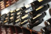 Wine bottles in shop — Stock Photo
