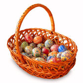 Easter eggs in a wattled basket — Stock Photo