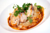 Rizotto with a fried pike perch in sauce — Stock Photo