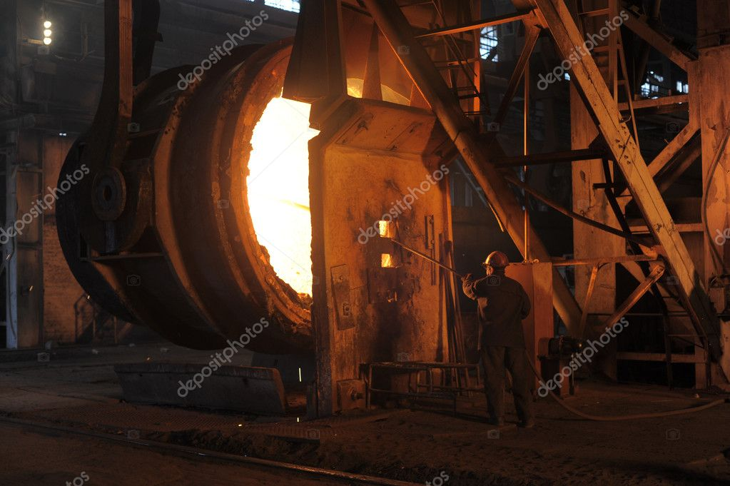 A steel worker takes a sample at steel company — Stock Photo #2187226