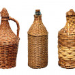 Stock Photo: Vessels for wine in straw braid