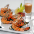 Shrimps and mussels with sauce - Stock Photo