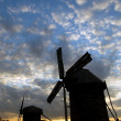 Royalty-Free Stock Photo: Windmills against the sunset sky