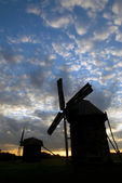 Windmills against the sunset sky — Stock Photo