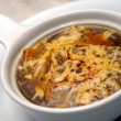 Onions soup with fua-gra and cheese — Stock Photo