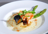 Seafood with an asparagus — Stock Photo
