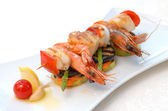 Shish kebab from seafood — Stock Photo