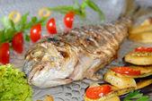 Fried fish dorado with vegetables — Stock Photo