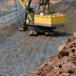 Stock Photo: Big dredge in mine