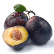 Plum and a half — Stock Photo