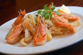 Fried shrimps and squids — Stock Photo