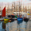 Sailing boats and stand in port — Stock Photo