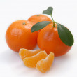 Stock Photo: Three clementines with segments