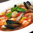 Tomato soup with seafood and fish - Stock Photo