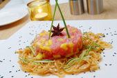 Tar-tar from a tuna and avocado — Stock Photo