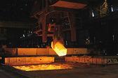 The heated steel pigs the crane — Stock Photo