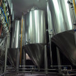 Steel tanks for beer manufacture - Stock Photo