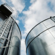 Stock Photo: Refinery ladder and tanks