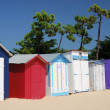 Coloured Beach huts under the sunlight - Stock Photo