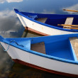 Small white and blue wooden boats — Stock Photo