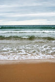 Stormy sea waters on the beach — Stock Photo