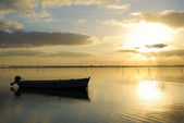 Small boat at the sunrise — Stock Photo