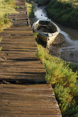 Pontoon and small boat in the land — Stock Photo