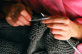 Knitting hands — Stock Photo