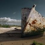 White rusty prow on the beach — Stock Photo #2180093