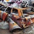 Stock Photo: Deteriorated rusty car