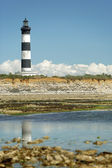 Lighthouse at low tide — Stock Photo