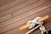 Sailing knot on a wooden floor — Stock Photo